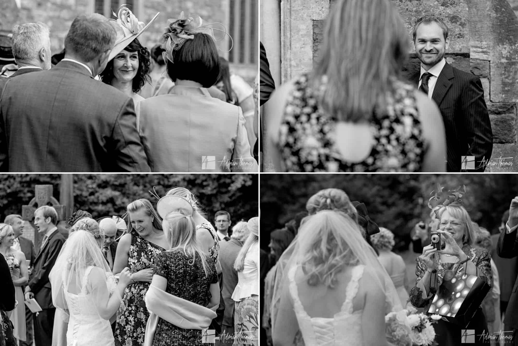Guest mingle with bride outside church.