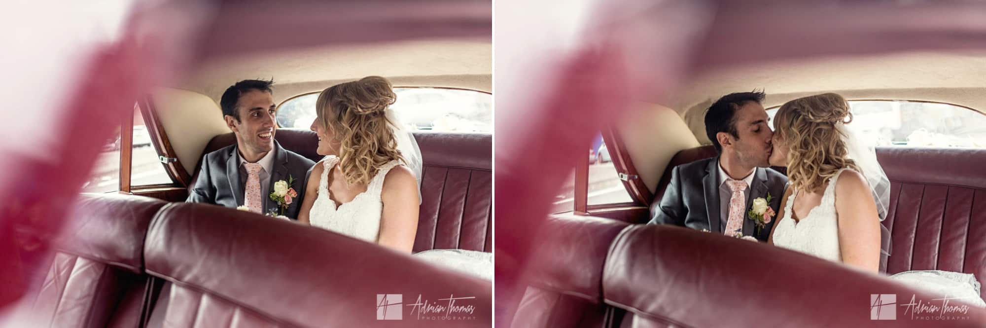 Bride and groom in wedding car.
