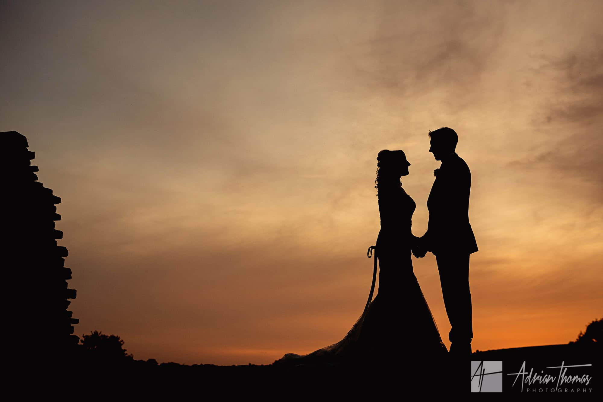 Image of wedding couple silhouette at Caerphilly Castle.
