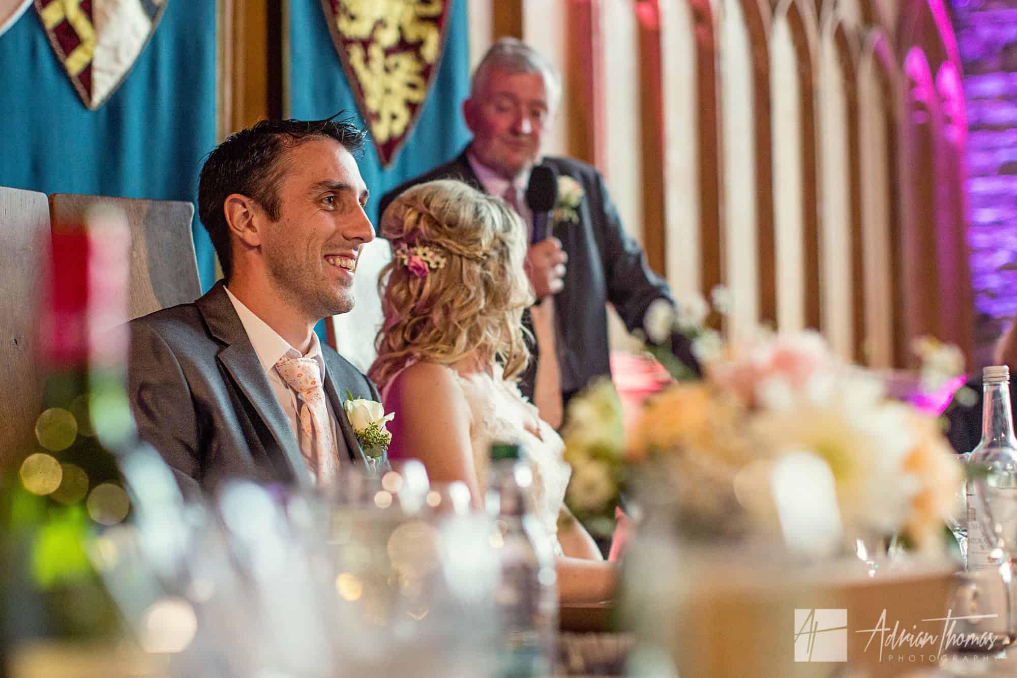 Groom at wedding reception.