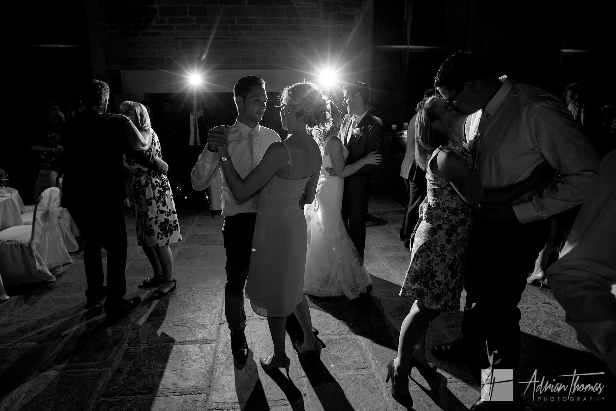 Guests slow dance.