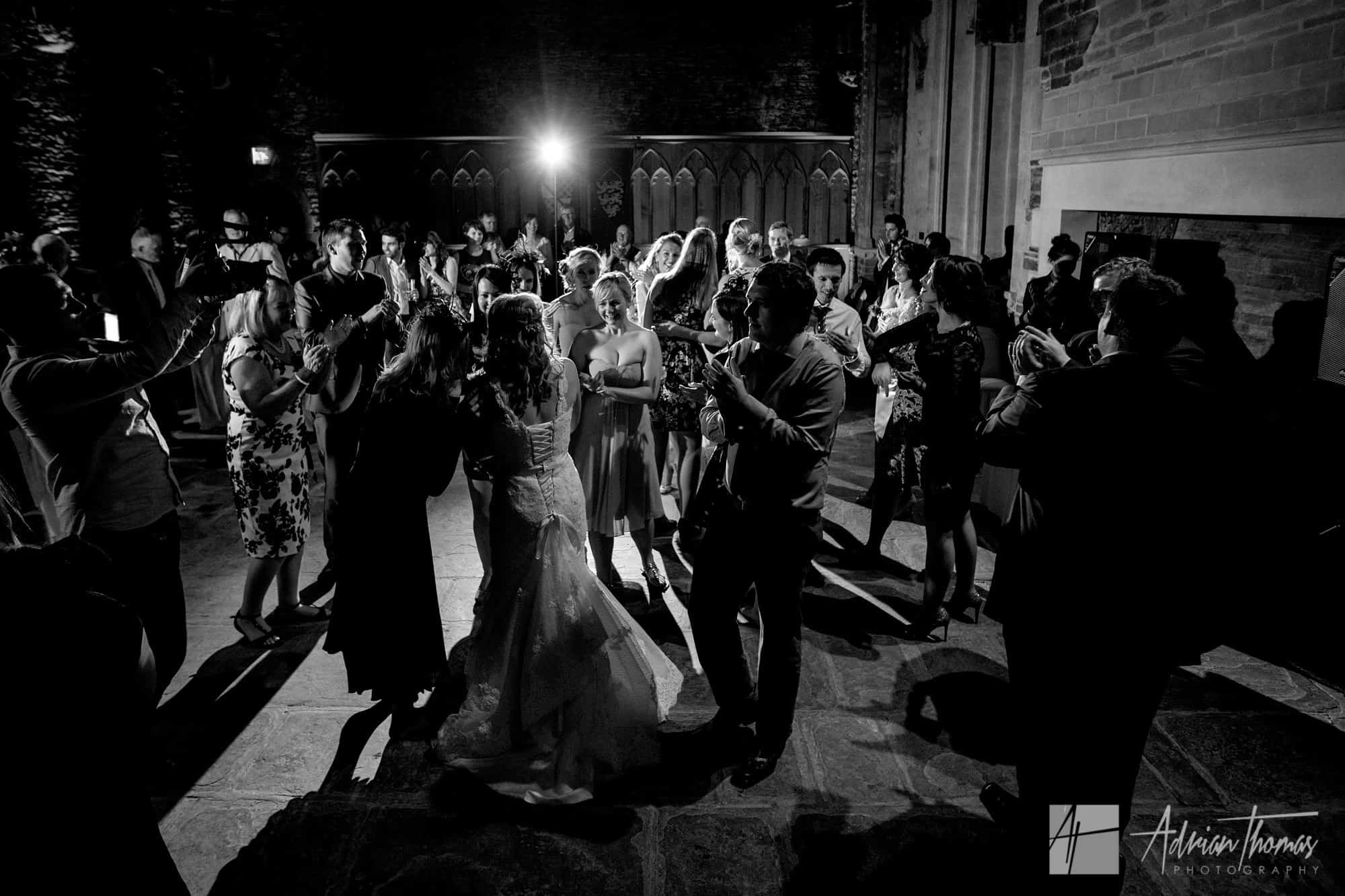Guests dancing at wedding.