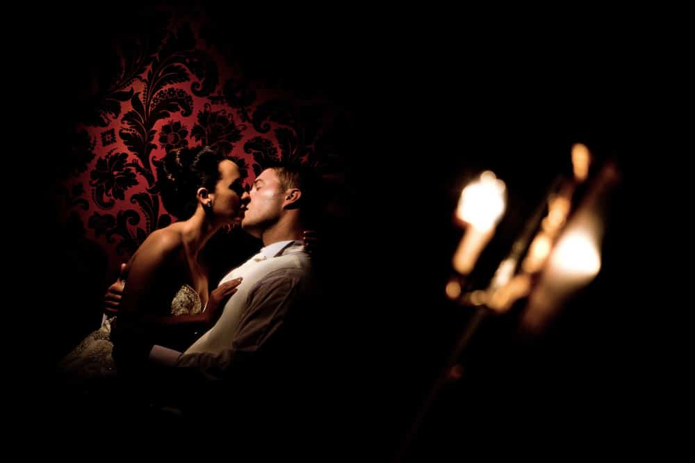 Image of bride and groom kissing in New House Hotel Cardiff