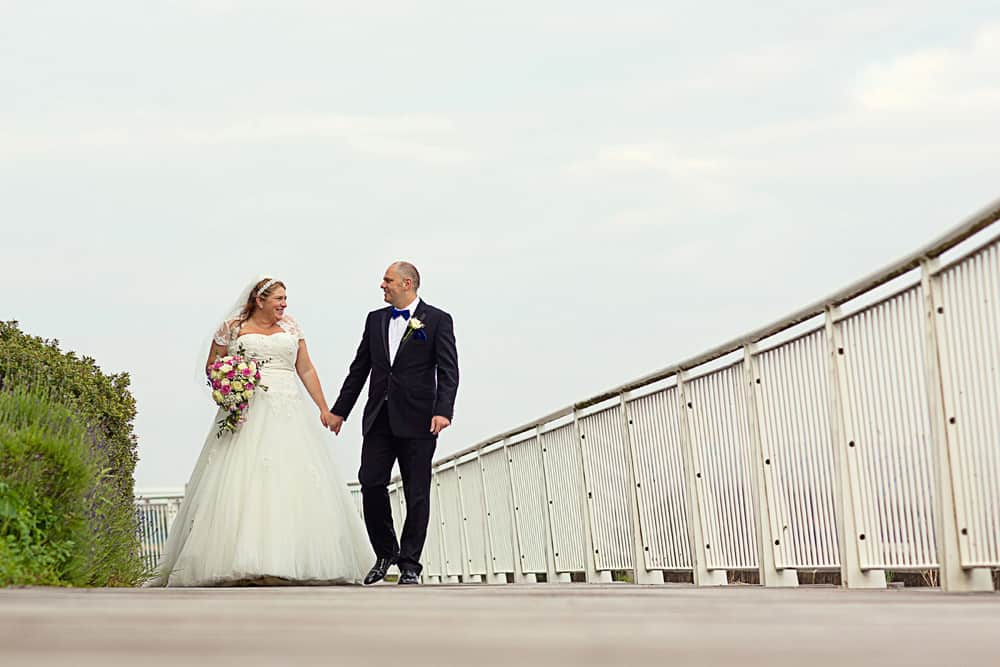 Bride and Groom Walking at St Davids Hotel, Thank you for booking me.