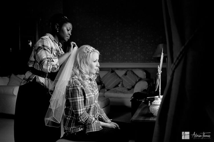 photo of bride having veil fitted to hair for her Clearwell Castle wedding.