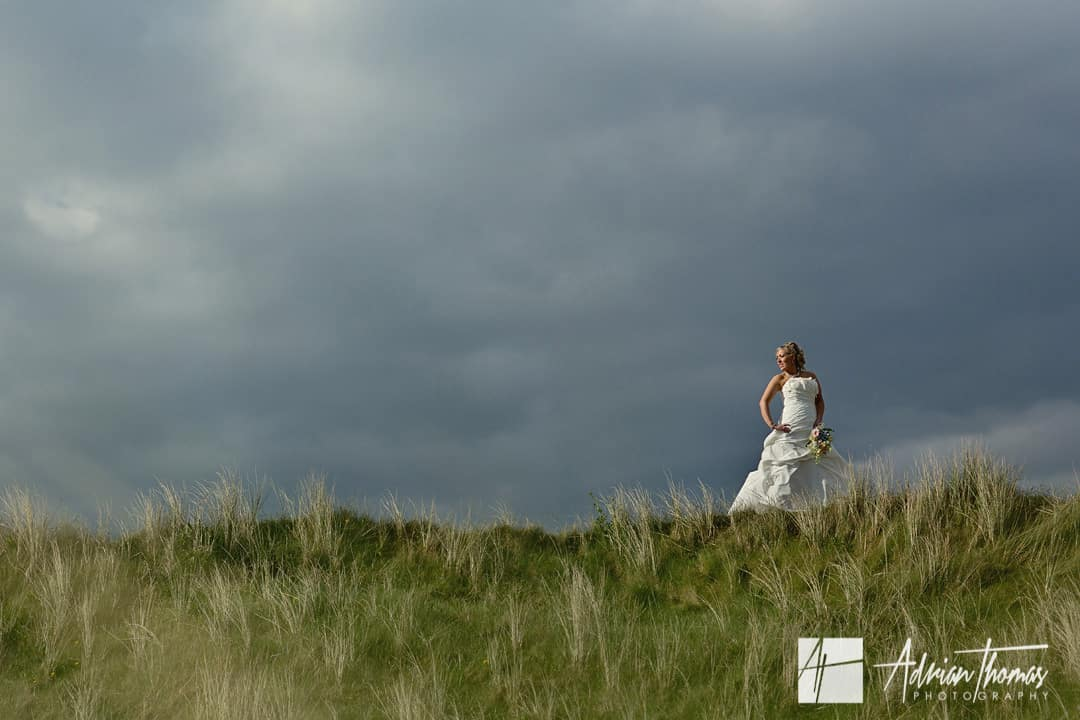 Bride during Llanelli wedding on Burry Ports sand dunes