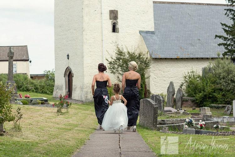 Bridesmaids walking.