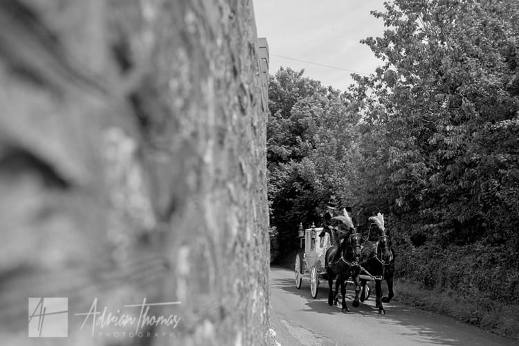 Bride arriving at st edeyrns church in horse and carriage