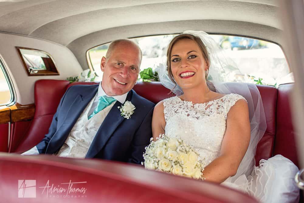 Bride and dad in car.