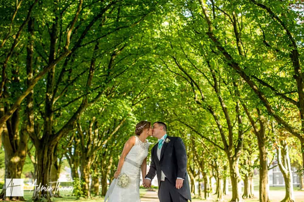 Photograph of wedding couple kissing at Hensol Castle grounds