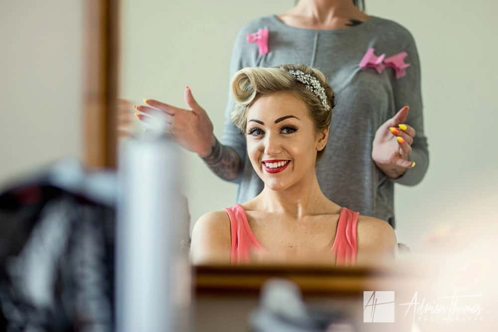 Image of Bride having hair done at Buckland Hal.