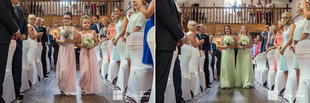 bridesmaids walking down isle.