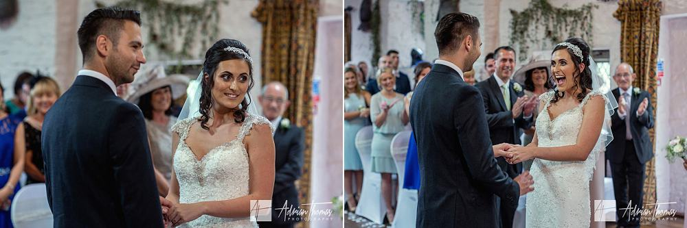 Happy bride during wedding ceremony at Miskin Manor Hotel
