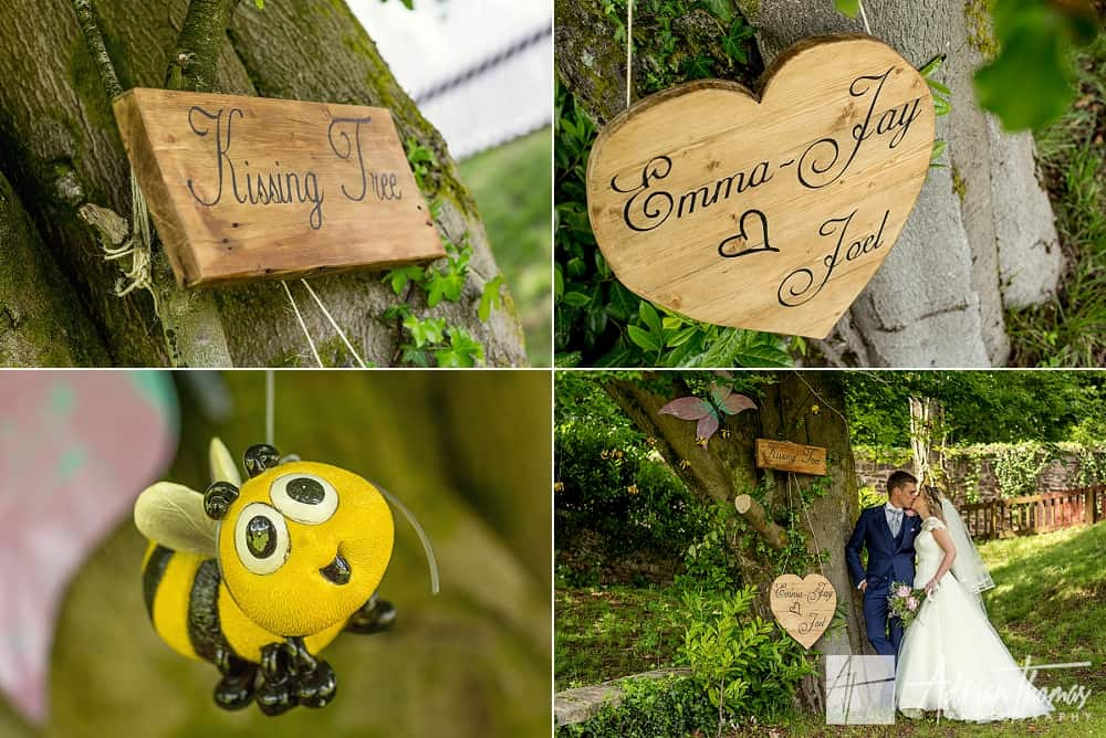 Bride and groom at surprise kissing tree created by their family
