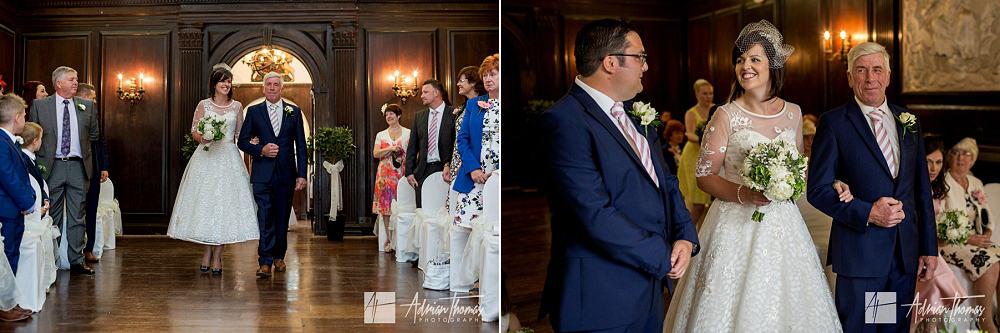 Bride walking up isle to her groom