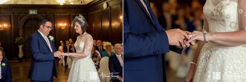Bride and groom exchange wedding rings in Hercules Room at Portmeirion Village