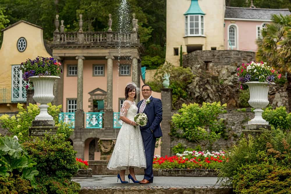 Image of bride and groom in gardens during their Portmeirion Village wedding.