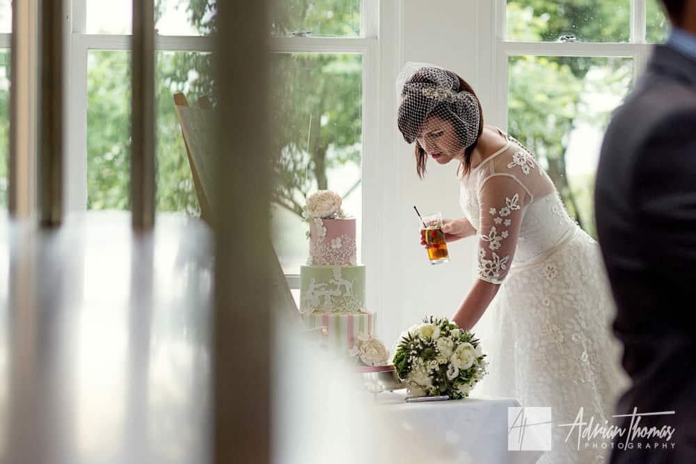 Brdie looking at her wedding cake