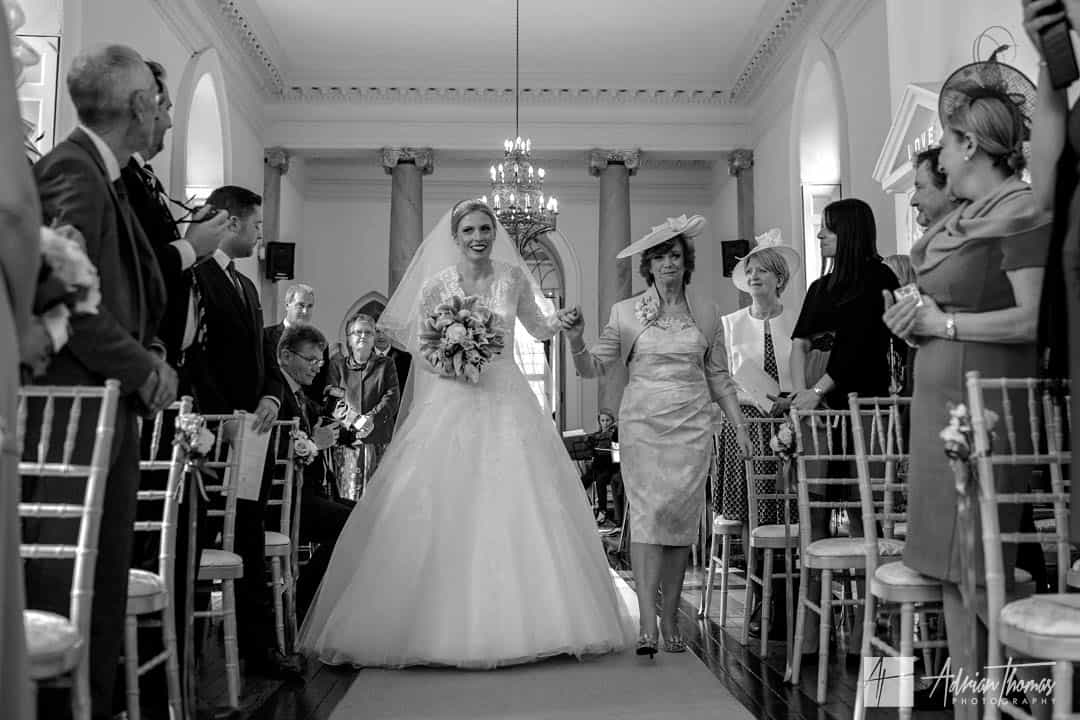 Bride and her mother walking down the aisle.