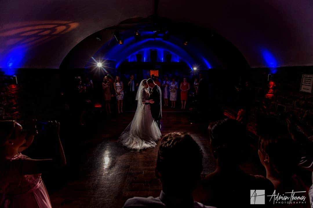 Image of bride and groom having their first dance at Clearwell Castle wedding venue.