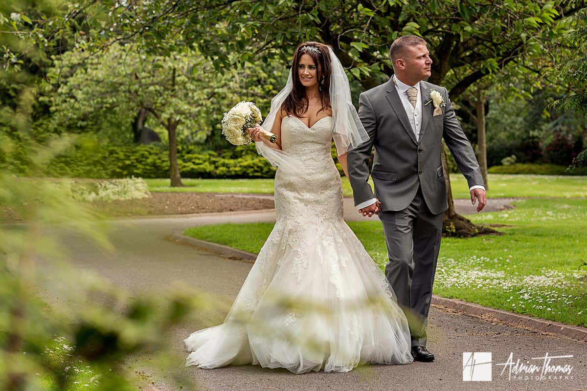 Wedding Couple at romantic walk at Cardiff park.