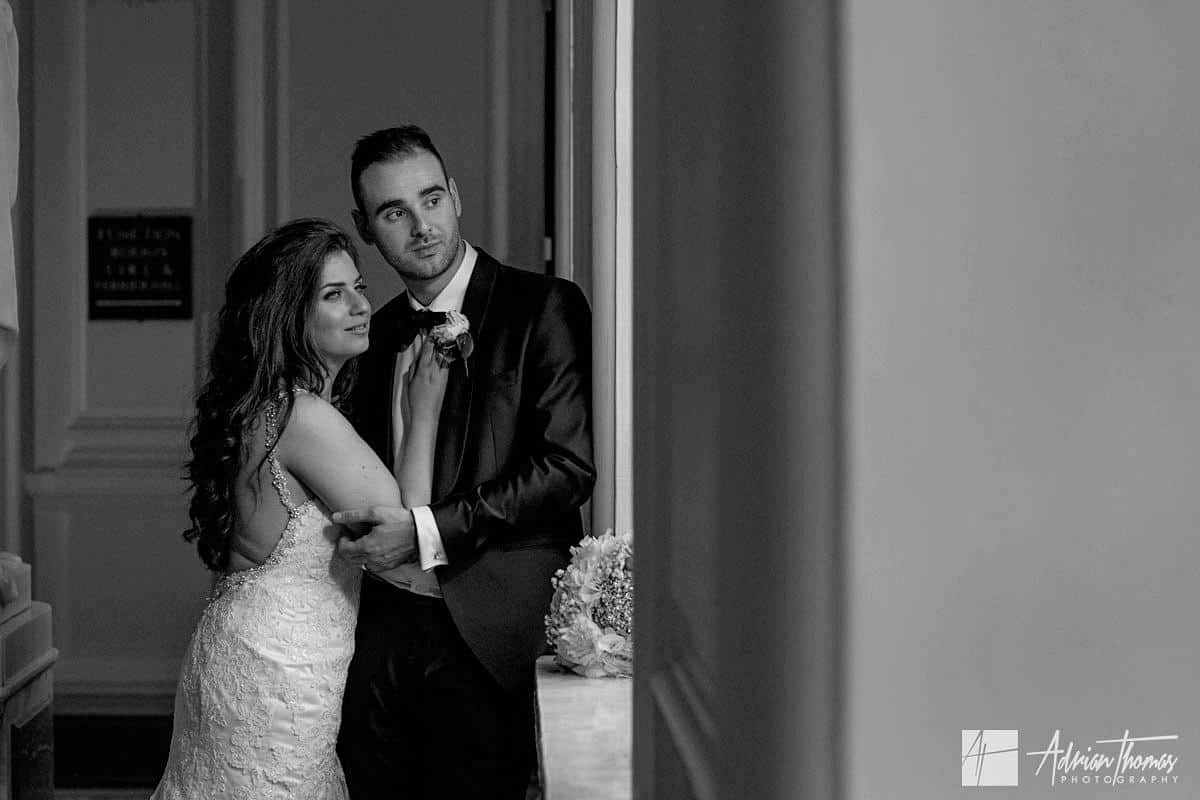 Image of Bride and Groom at Cardiff City Hall in window light.