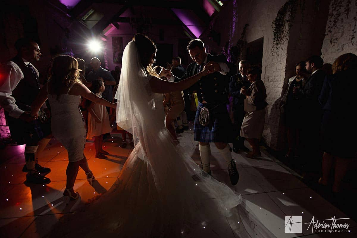 Bride and groom dancing at their Miskin Manor wedding reception.