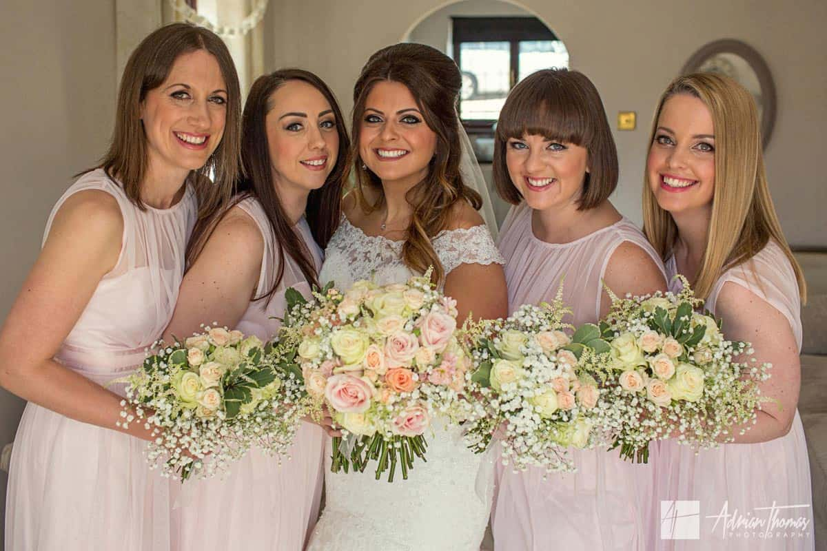 Image of all bridesmaids and bride in house