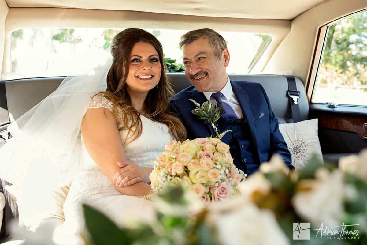 I(mage of bride and her dad in the car arriving at Ystrad Mynach Church.