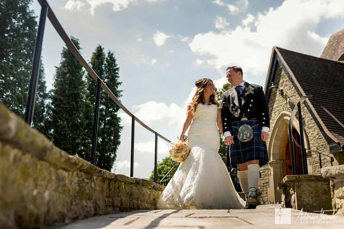 Bride and groom walking hand in hand.