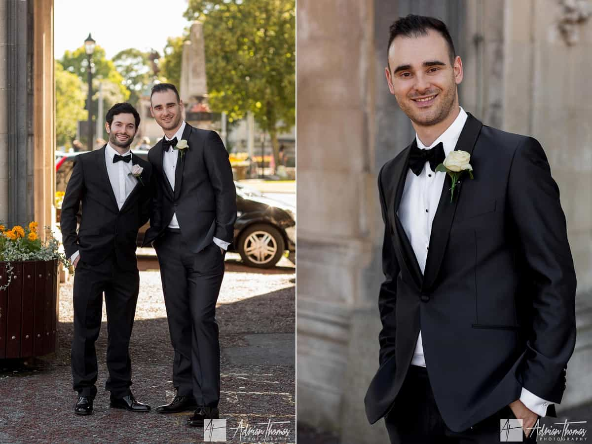 Groom and bestman outside City Hall Cardiff wedding venue in city centre.