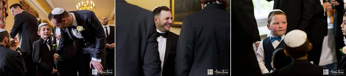Image of groom and friends laughing before his wedding.