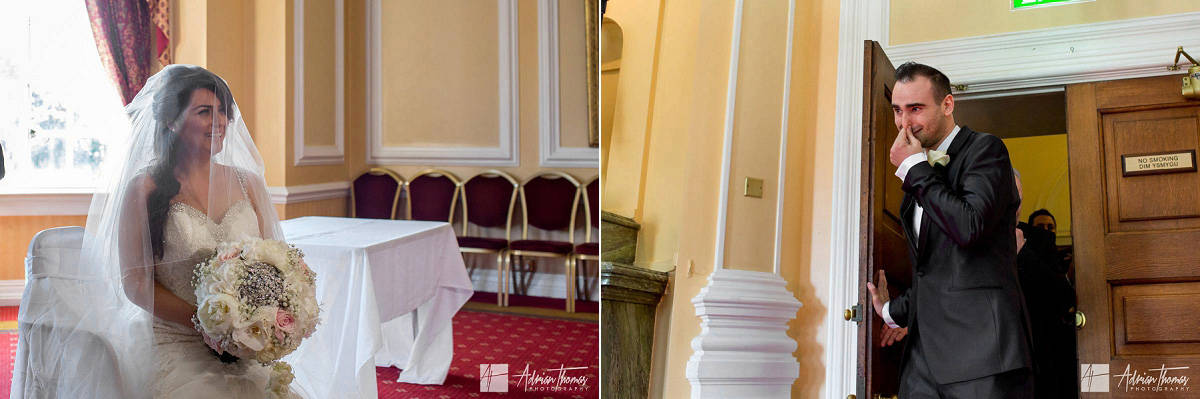 Groom crying at bride during Bedeken veiling ceremony at Jewish City Hall Cardiff wedding.