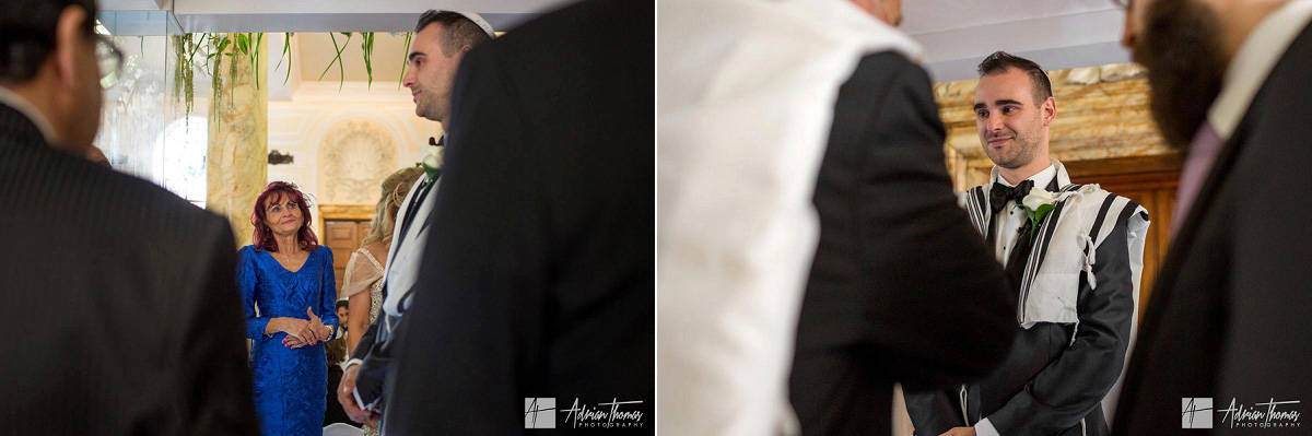 Grooms mother watching her son during their Jewish City Hall Cardiff wedding ceremony.