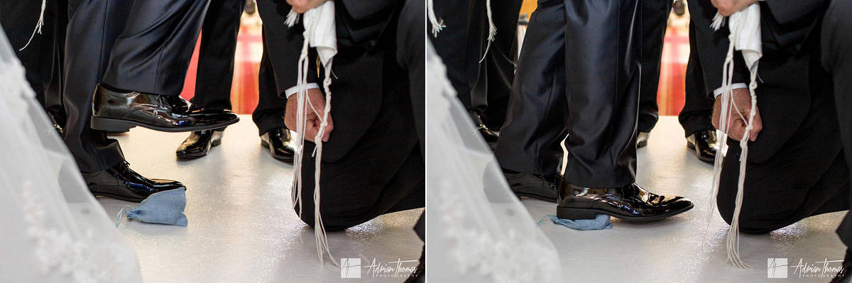 A glass wrapped in cloth and broken by the groom foot and shoe.