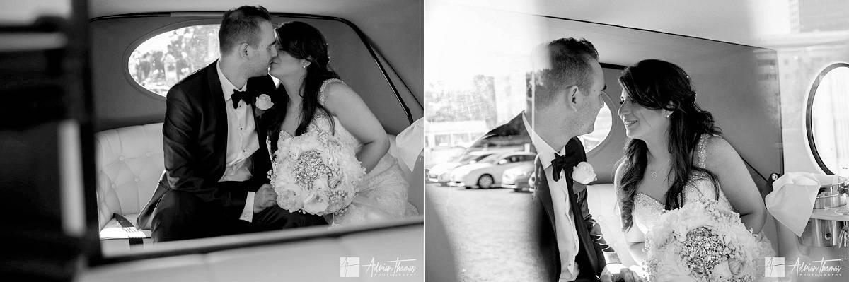 Bride and groom in their wedding car.