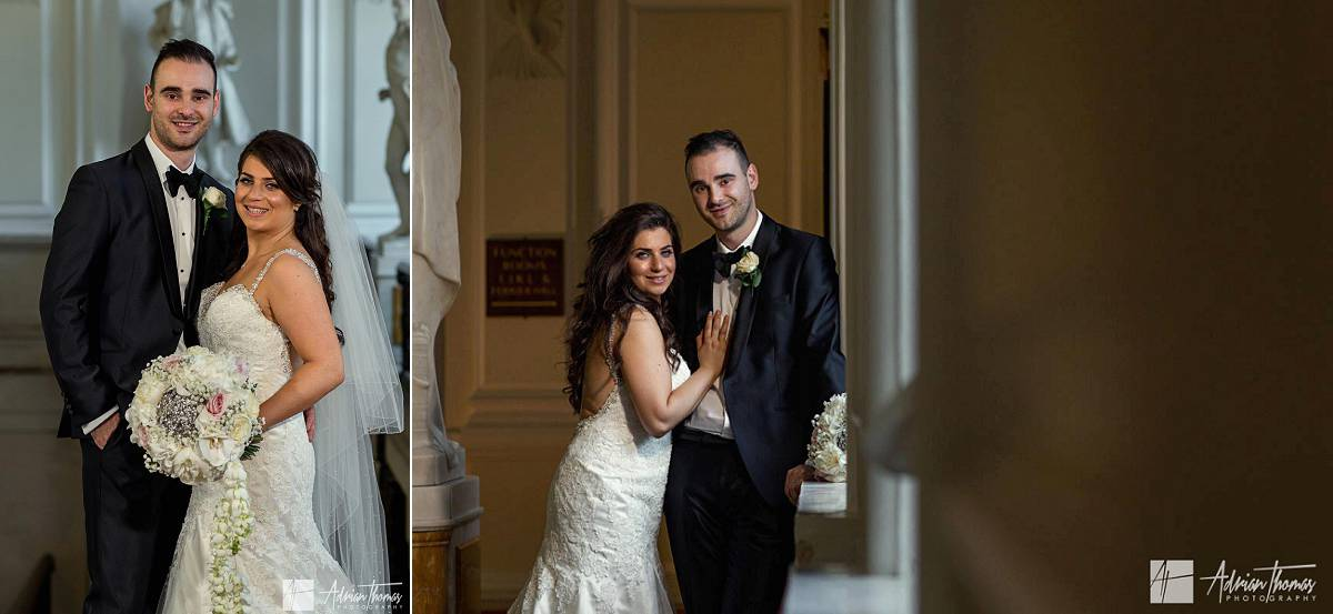 Portrait of the bride and groom inside their City Hall Cardiff wedding venue.