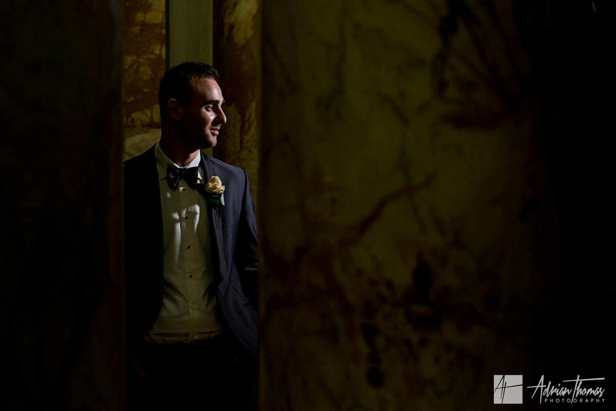 Portriat image of groom inside City Hall Cardiff wedding reception.