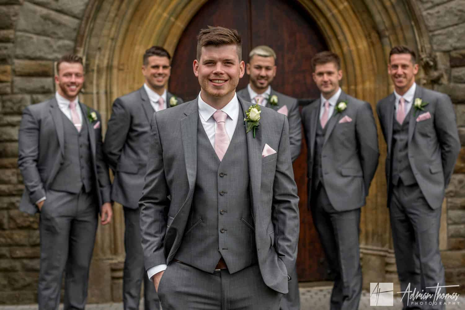 Groom and ushers outside St Martin's Church Caerphilly wedding.