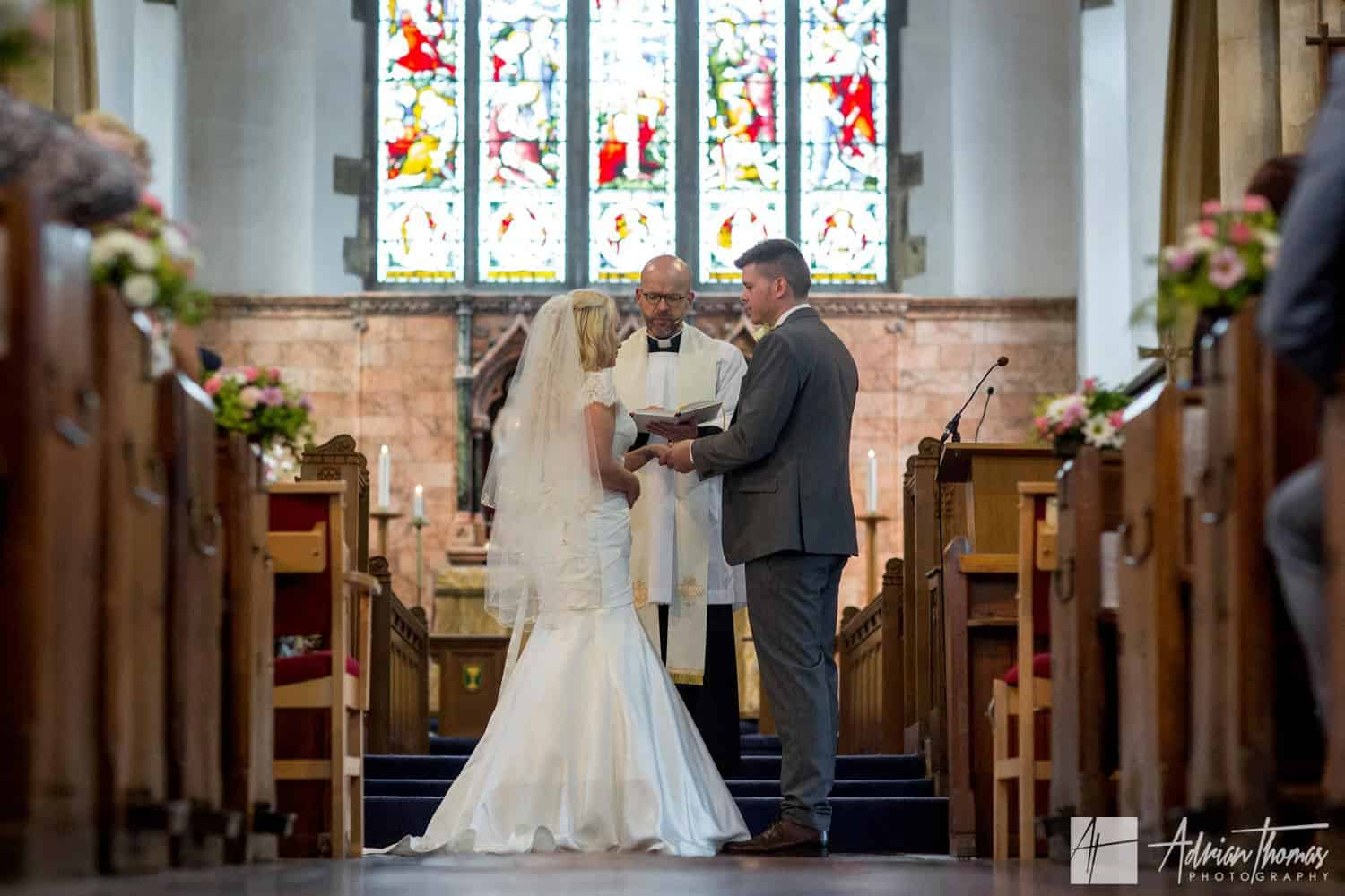 Full length image of bride and groom during St Martin's Church Caerphilly wedding.