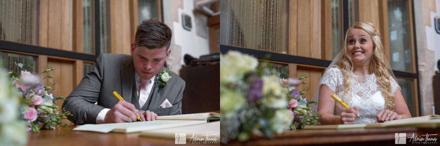 Extremely happy bride signing the register for her St Martin's Church Caerphilly wedding.