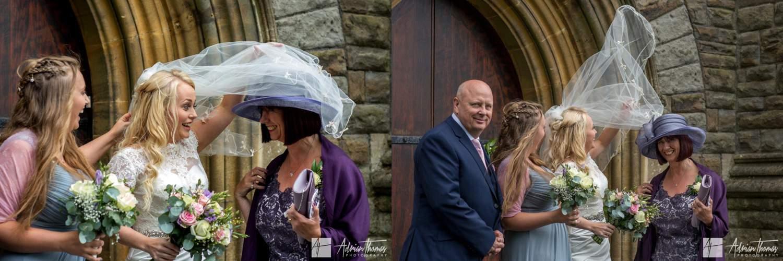 Wind blows brides veil into the air.