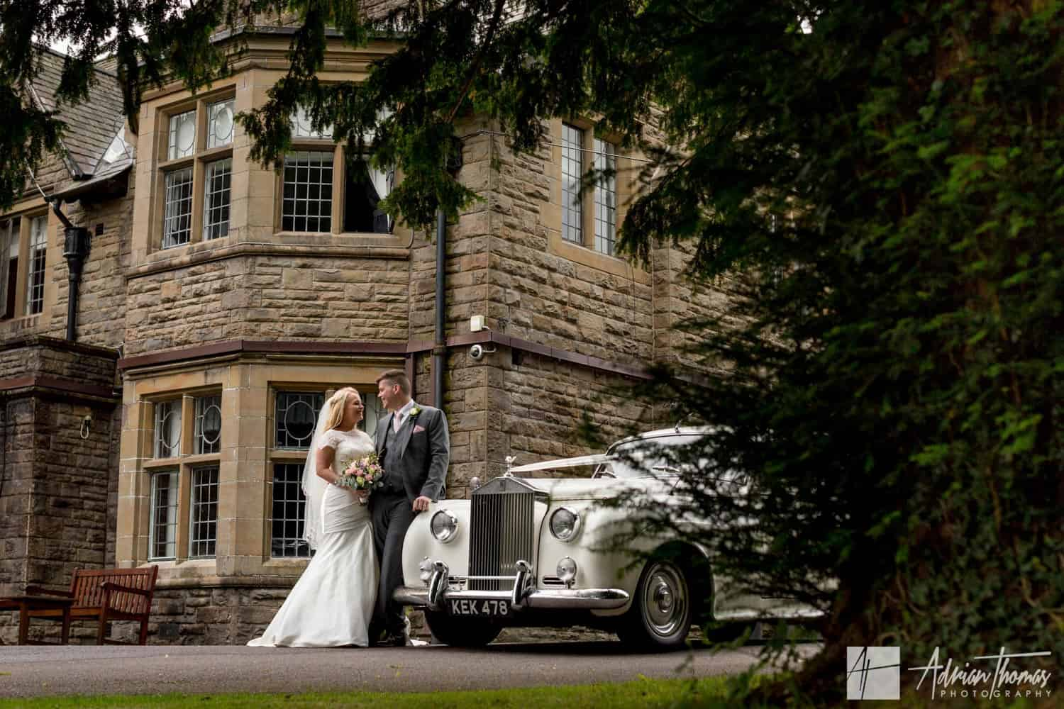Bride and groom with their car outside Maes Manor Hotel wedding reception Blackwood