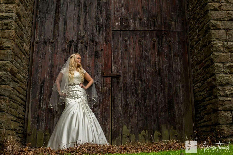 Bride posing for her Maes Manor Hotel wedding reception Blackwood gardens.