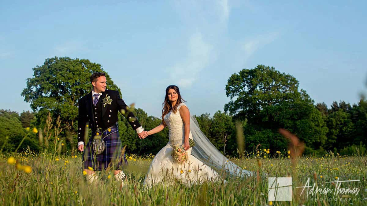Cardiff wedding photographer Image oPhotograph of bride and groom walking at Miskin Manor wedding reception.