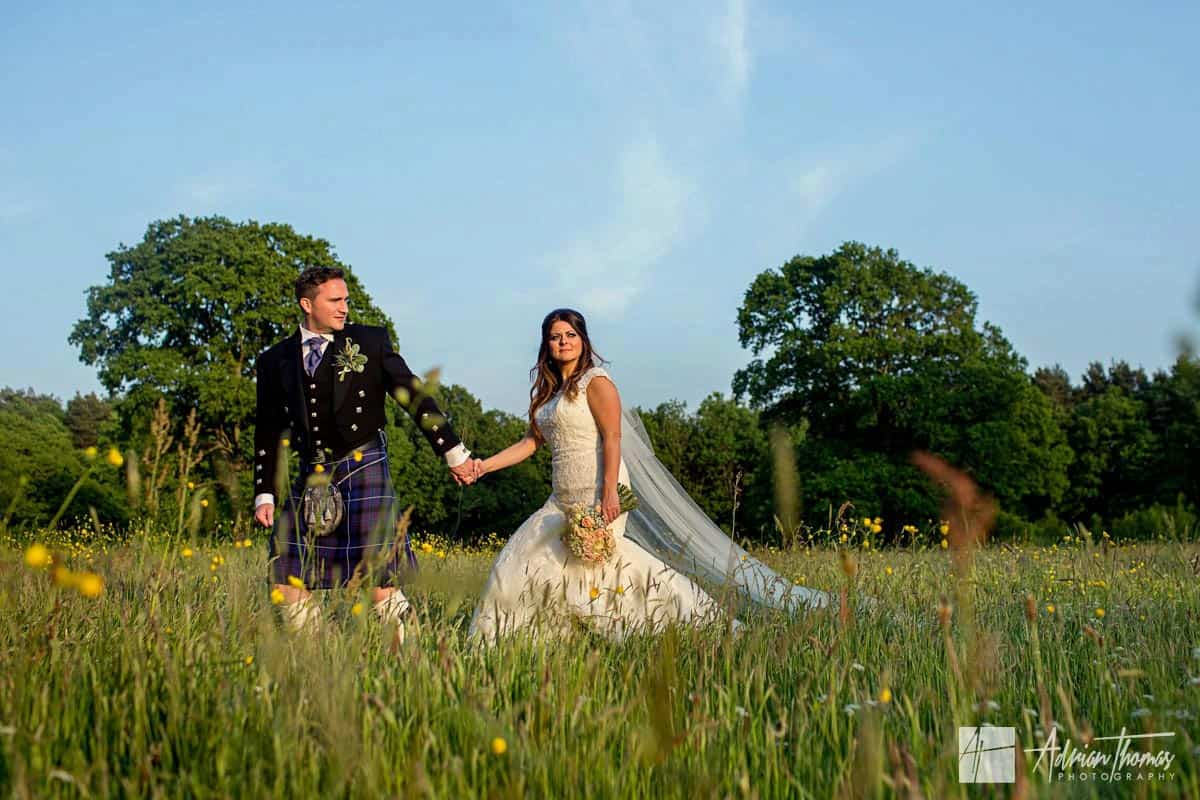 Image of Miskin Manor wedding venue with bride and groom walking.